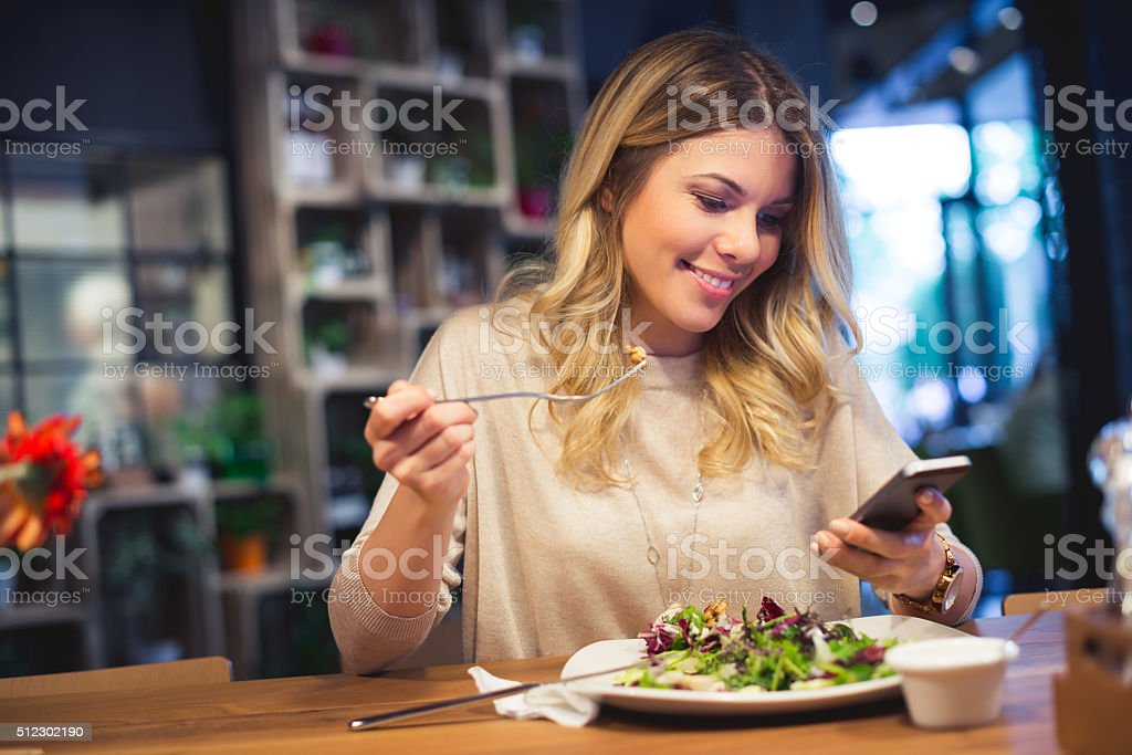 Surfing the web while eating stock photo