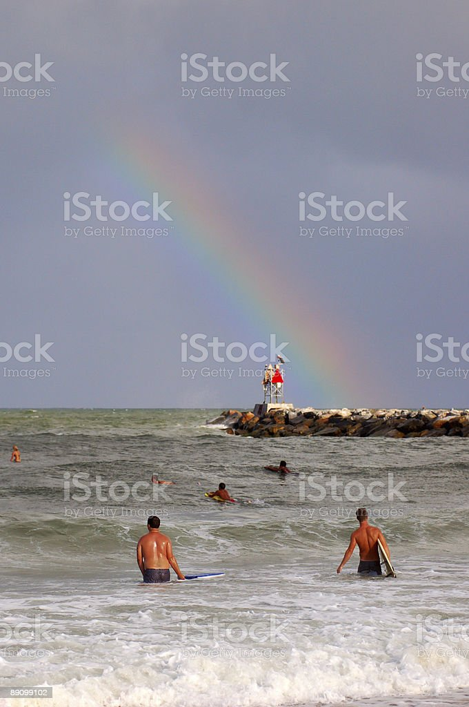 Surfing under the rainbow royalty-free stock photo