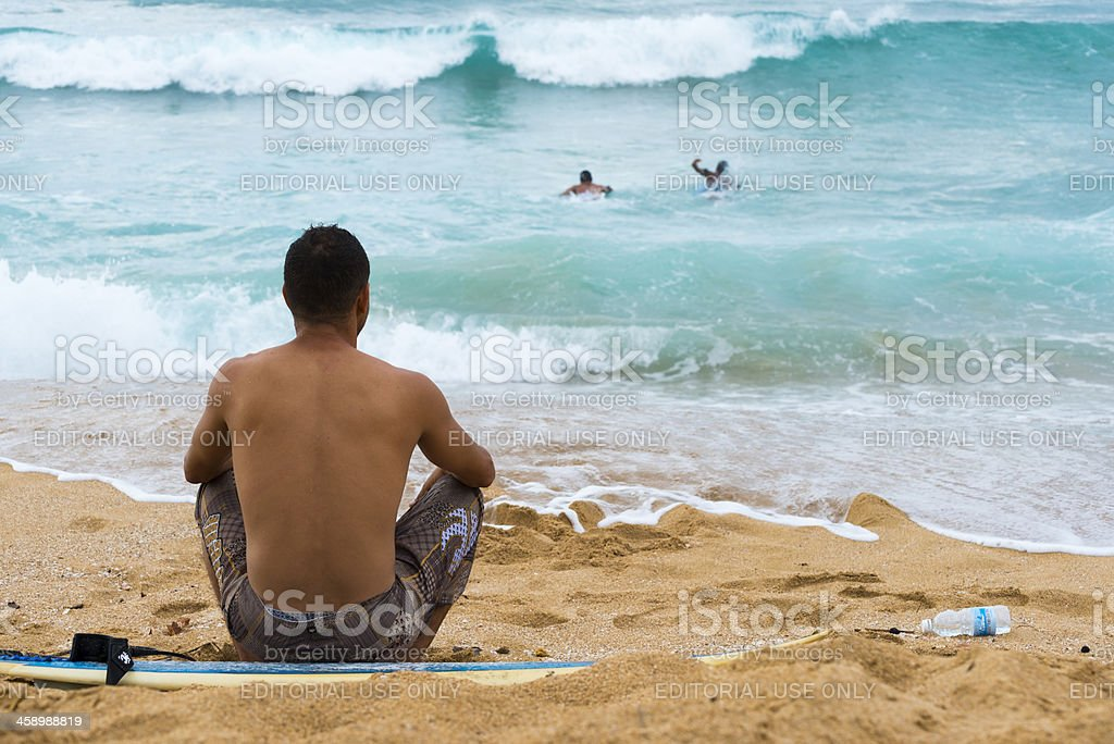 Surfing waves at beach stock photo