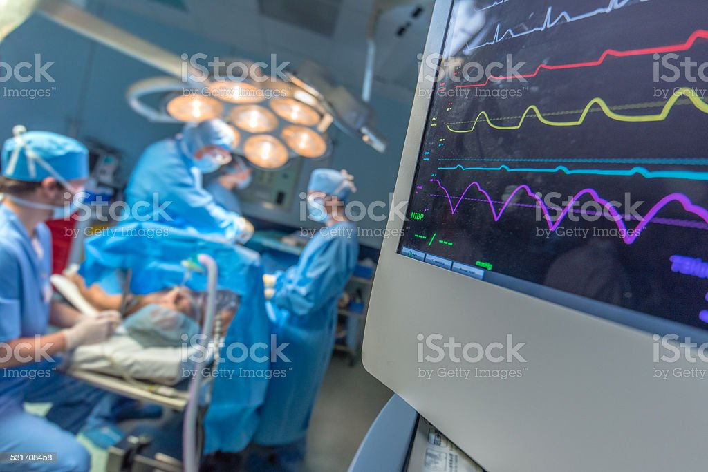 Surgeon and patient in operating theatre stock photo