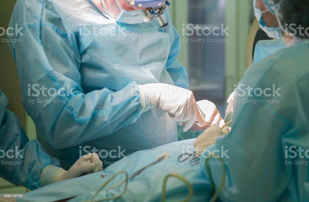 Surgeon at work. Surgery in hospital operating room stock photo