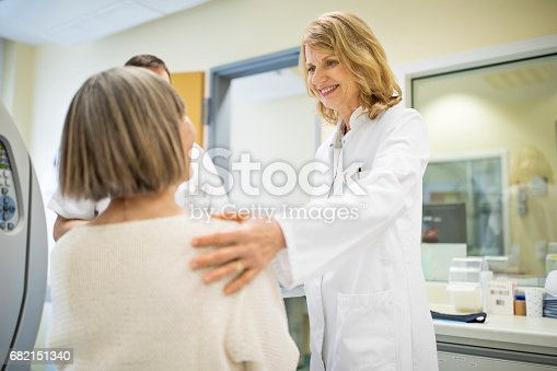 istock Surgeon consoling female patient at hospital 682151340