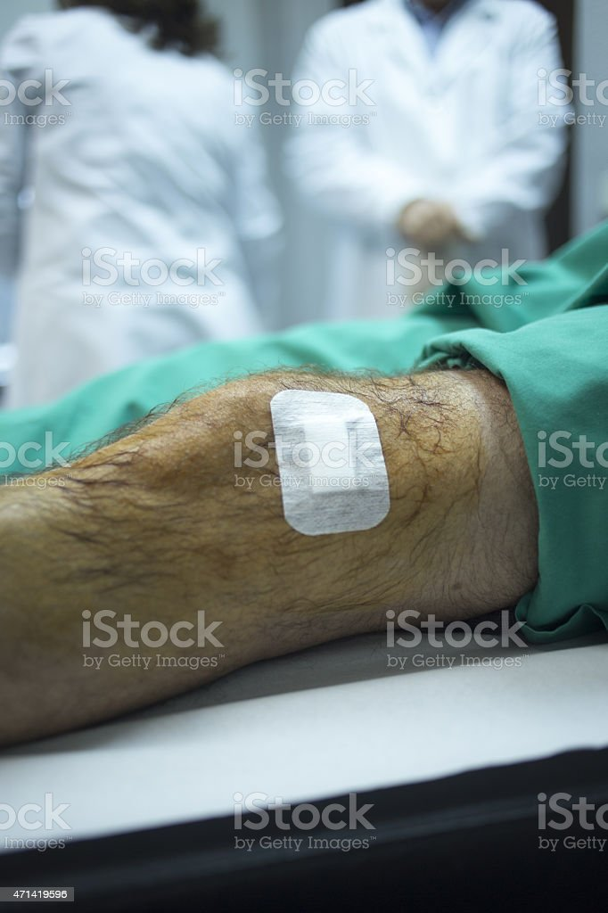 Surgeon doctor injecting patient in hospital clinic stock photo