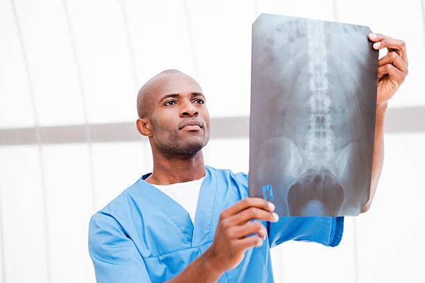 Surgeon examining X-ray image. stock photo