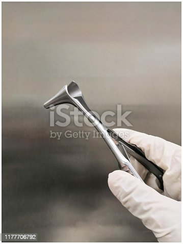 Surgeon Holding Nasal Speculum In Hand