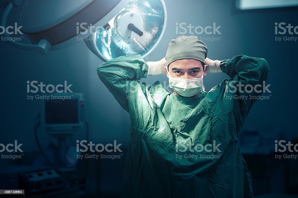 surgeon in theatre Getting Ready To Operate On A Patient stock photo