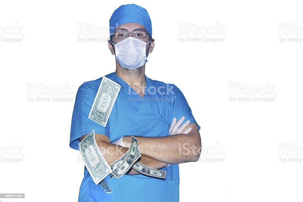 Surgeon Posing Behind Dollars stock photo
