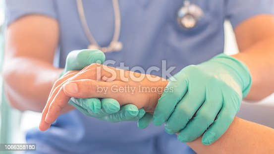 istock Surgeon, surgical doctor, anesthetist or anesthesiologist holding patient's hand for health care trust and support in professional ER surgical operation, medical anesthetic safety, healthcare concept 1066358180