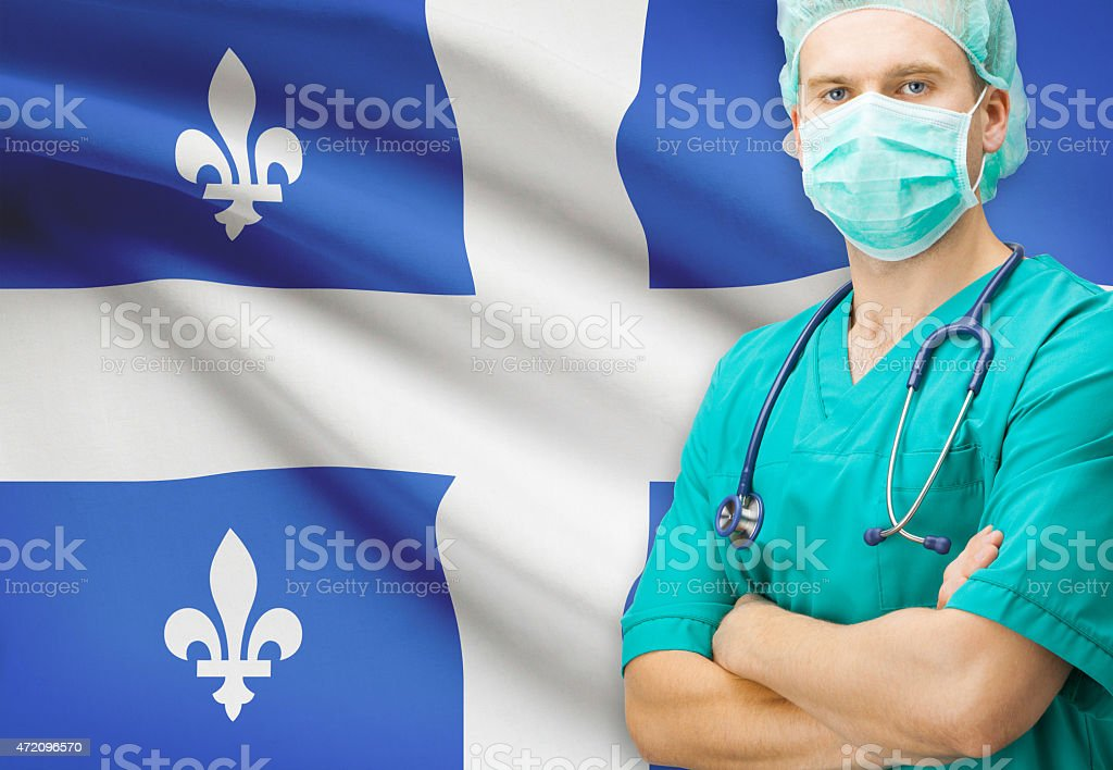 Surgeon with Canadian provinces flag on background series - Quebec stock photo