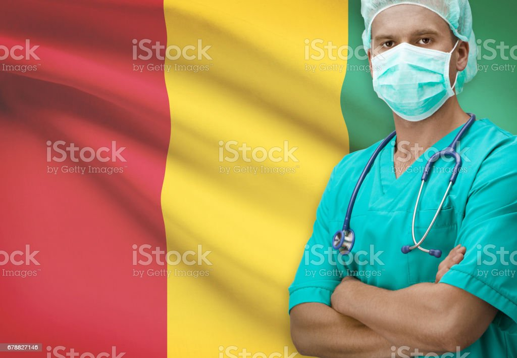 Surgeon with flag on background series - Guinea photo libre de droits