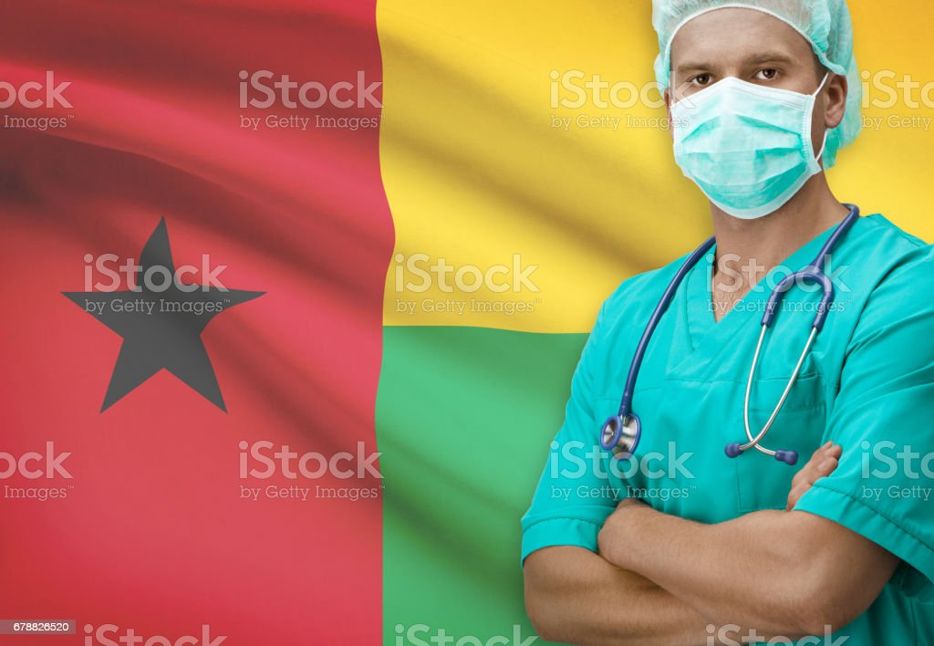 Surgeon with flag on background series - Guinea-Bissau royalty-free stock photo
