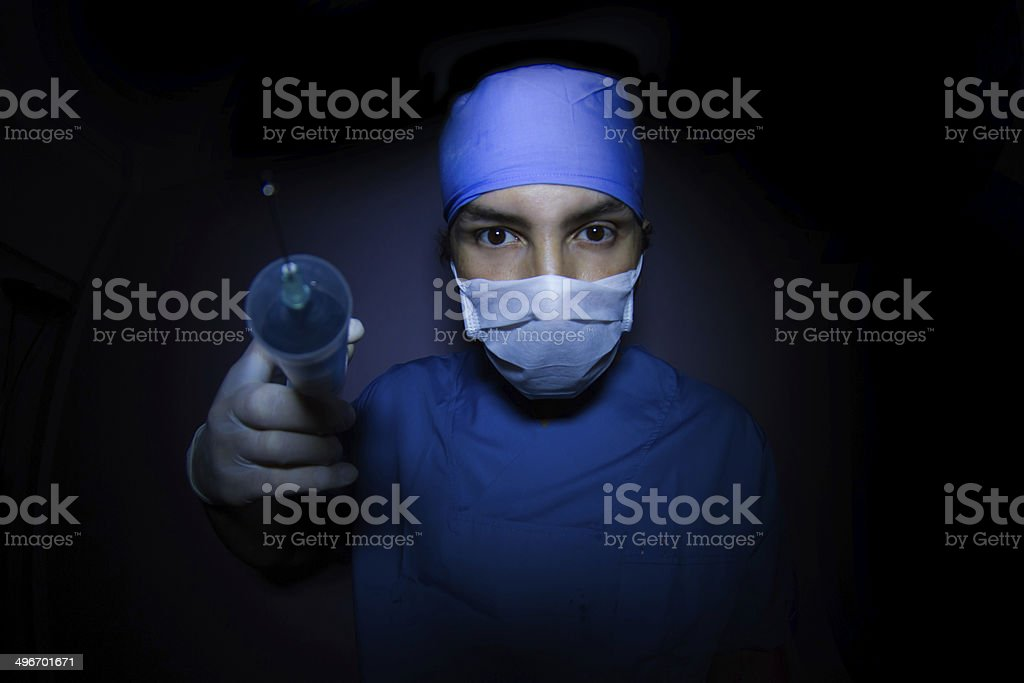 Surgeon  With Injection Syringe Looking At Camera stock photo