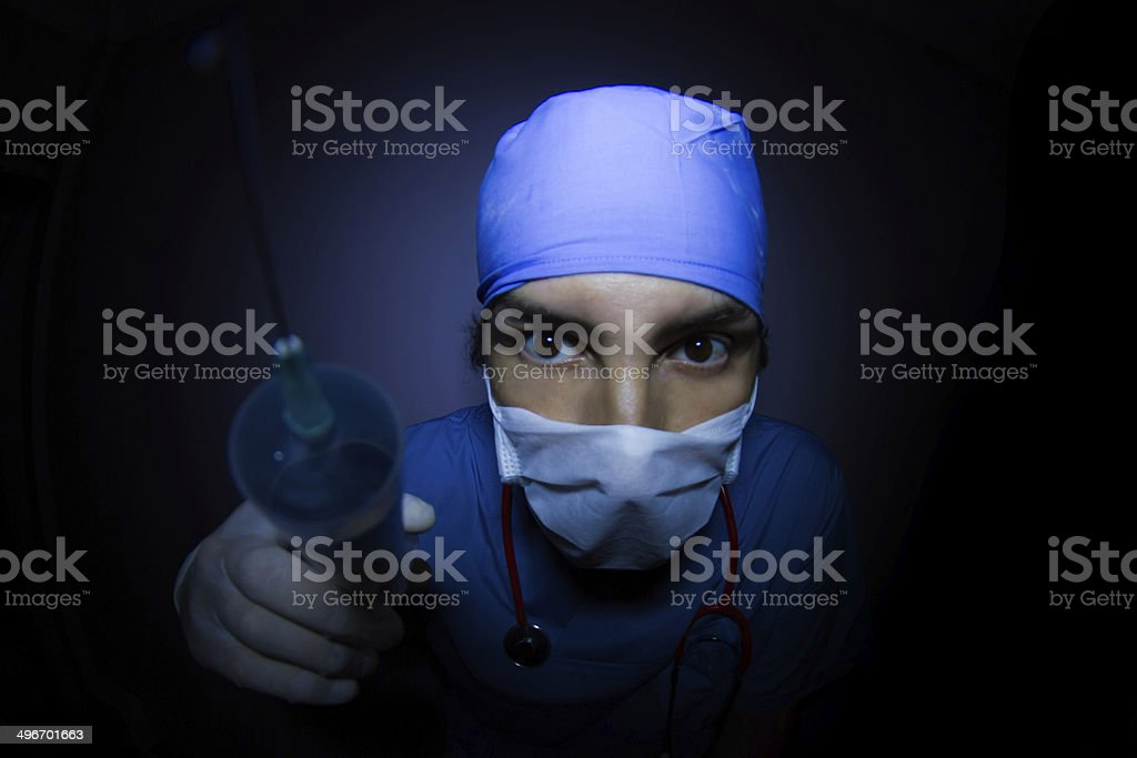 Surgeon  With Injection Syringe stock photo