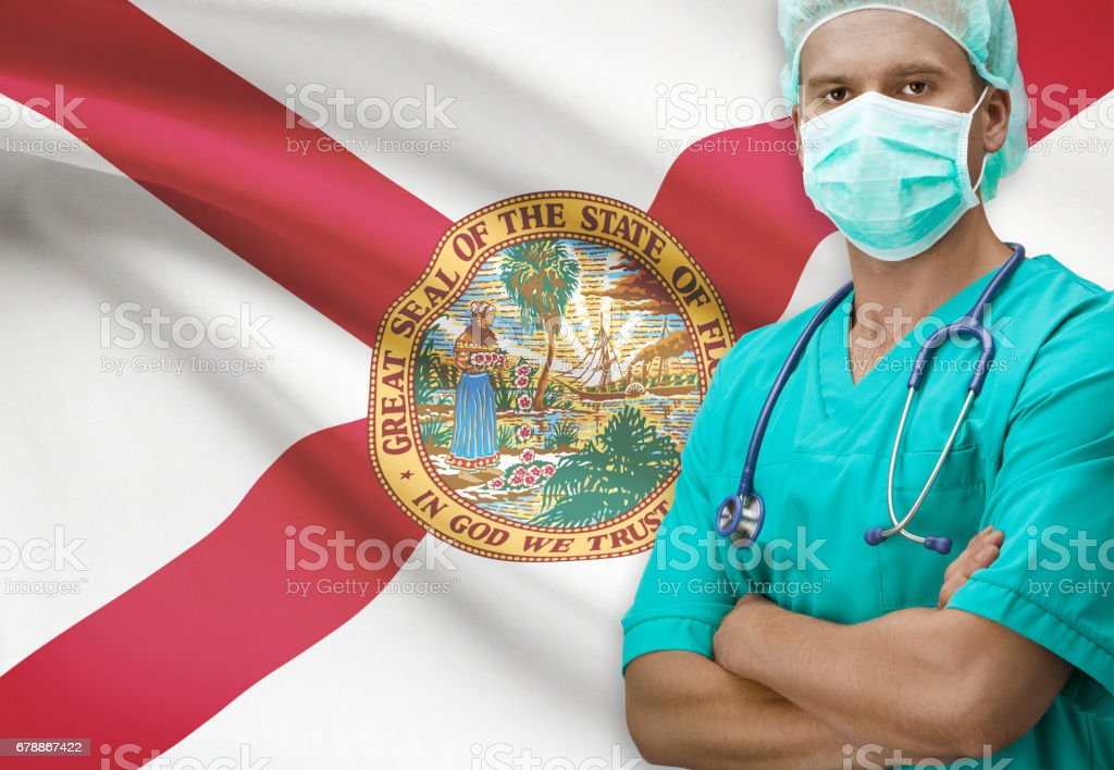 Surgeon with US states flags on background series - Florida photo libre de droits