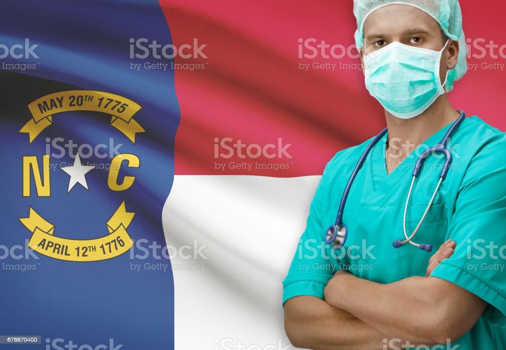 Surgeon with US states flags on background series - North Carolina photo libre de droits