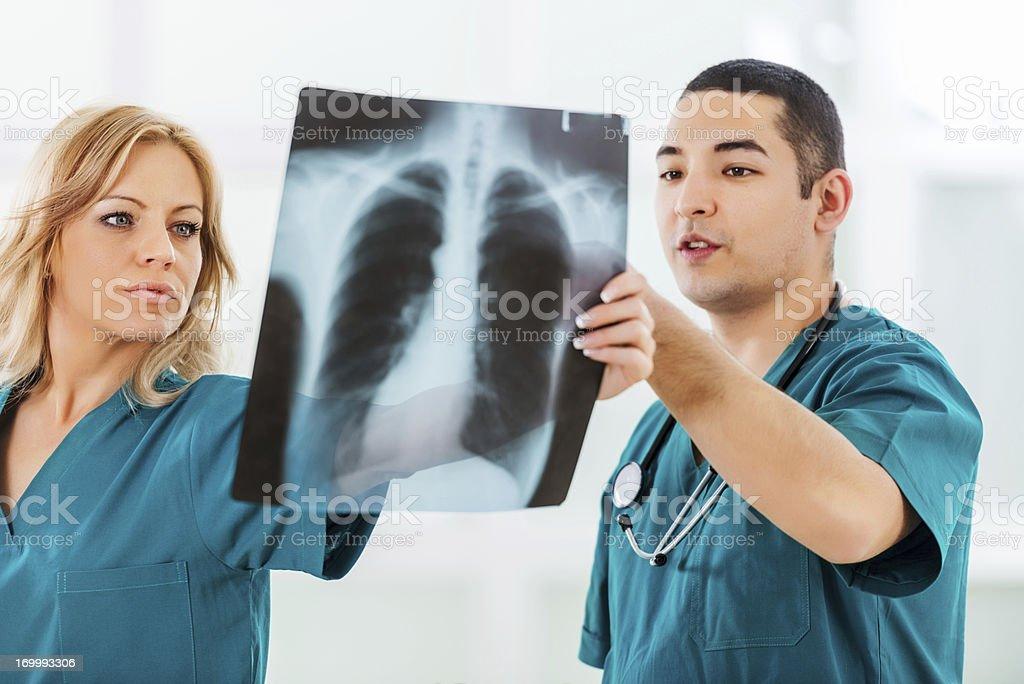 Surgeons examining MRI scan. royalty-free stock photo