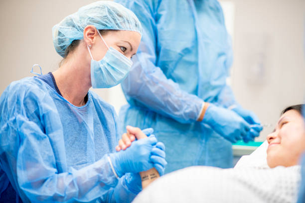 Surgeons in a hospital stock photo