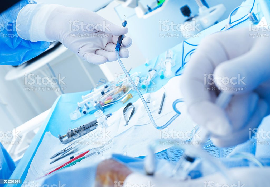 Surgeons in action stock photo