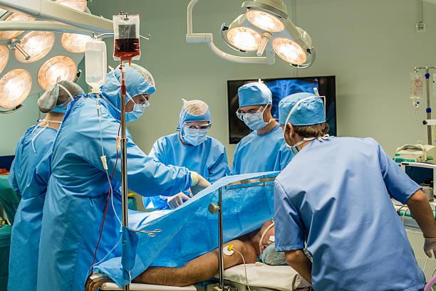 Surgeons in operating theatre stock photo