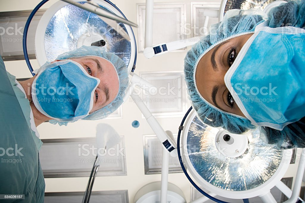 Surgeons looking down stock photo