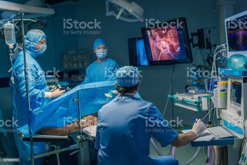 Surgeons performing surgery stock photo