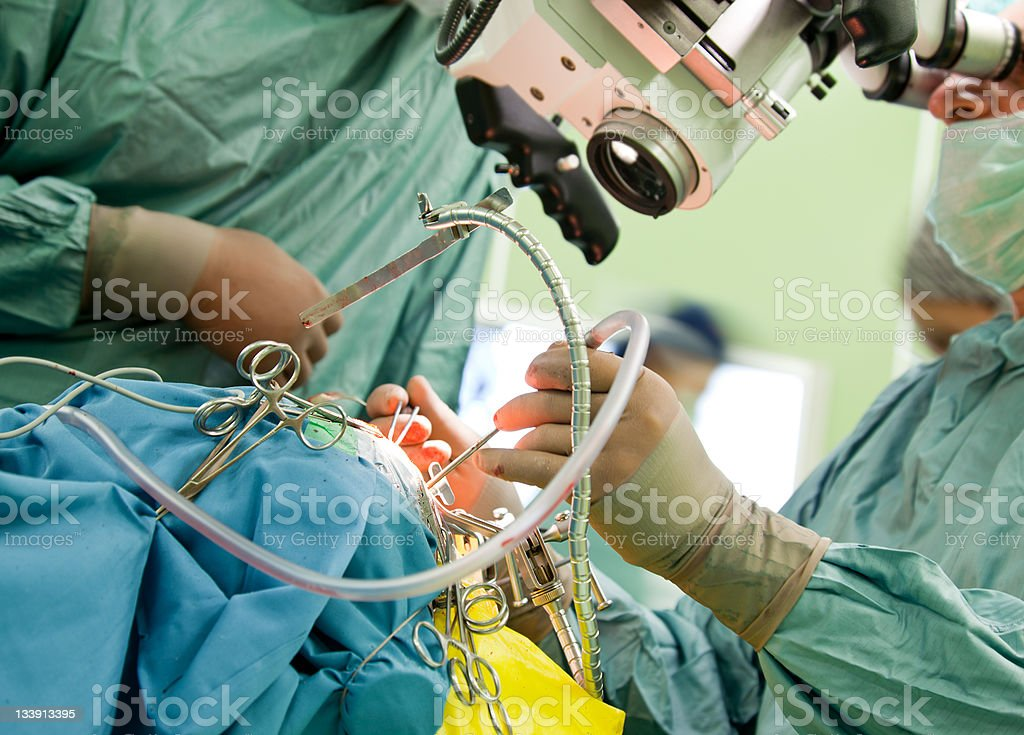 Surgeons performing surgical procedure stock photo