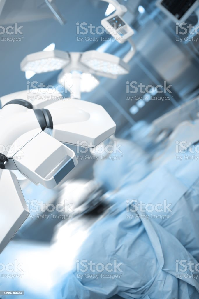 Surgeons silhouettes blurred in motion in the operating room royalty-free stock photo