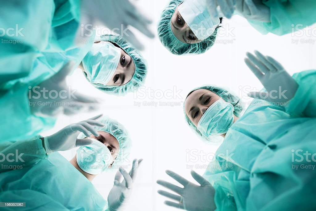 Surgeons standing above of the patient before surgery stock photo