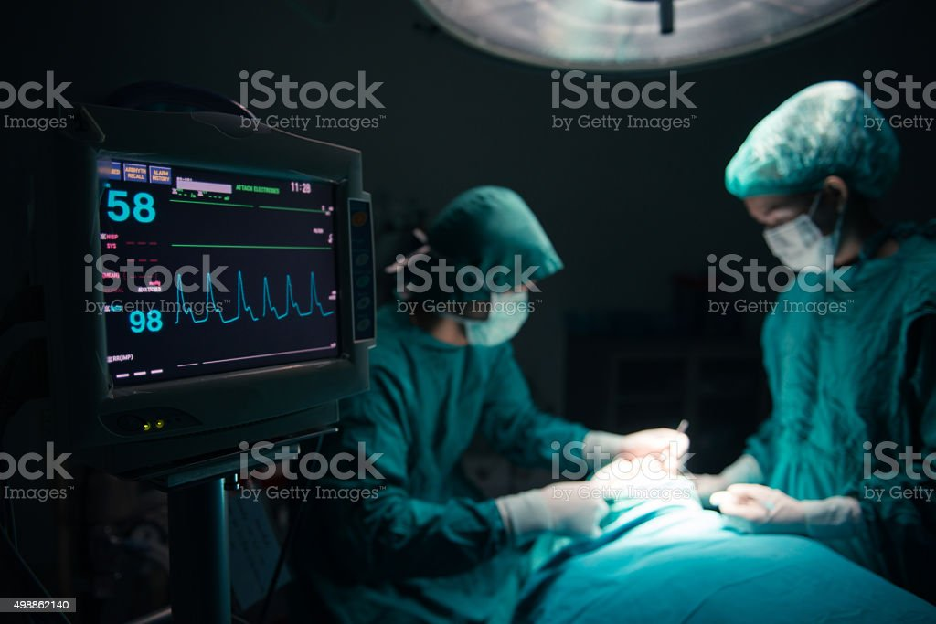 Surgeons team working stock photo