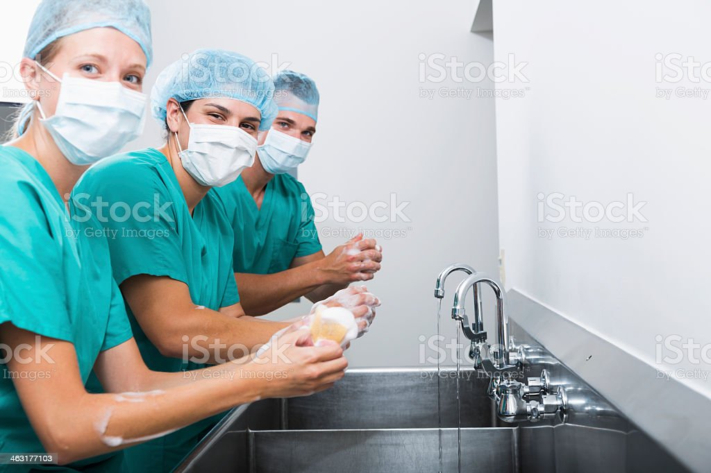 Surgeons washing hands stock photo