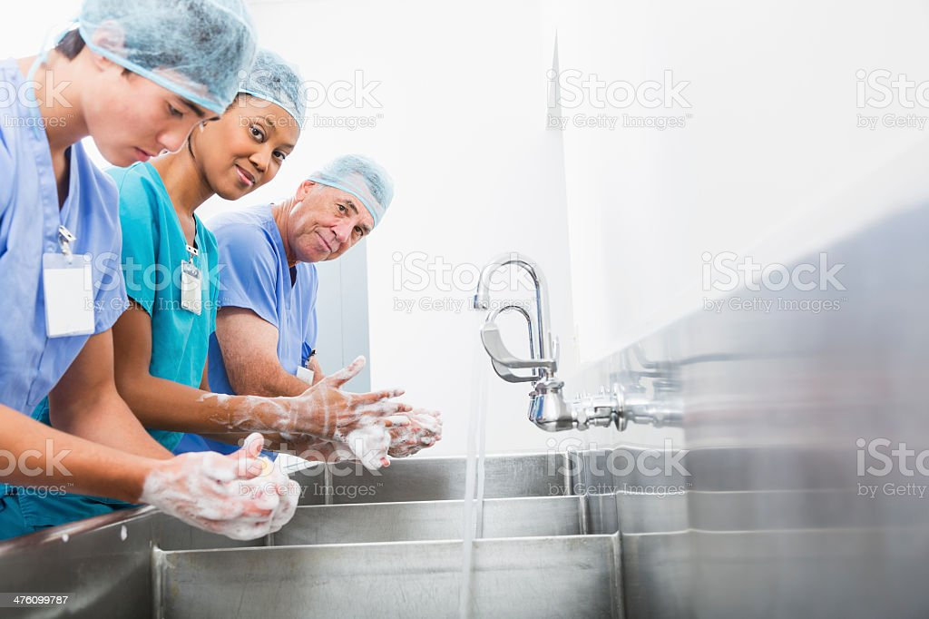 Surgeons washing hands stock photo