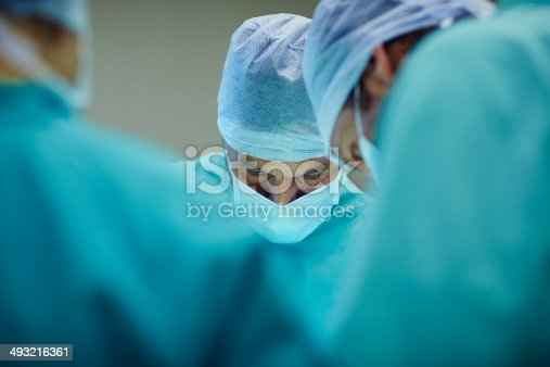 Male surgeons working in operating room at hospital