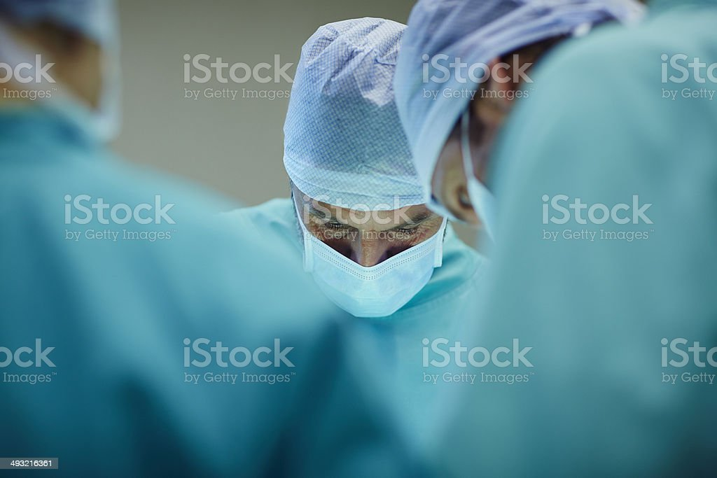 Surgeons working in operating room stock photo