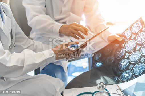 ER surgery medical team, surgical doctor teamwork, professional brain and neurological surgeon with digital tablet working in hospital clinic discussion, diagnosing on patient care operation service