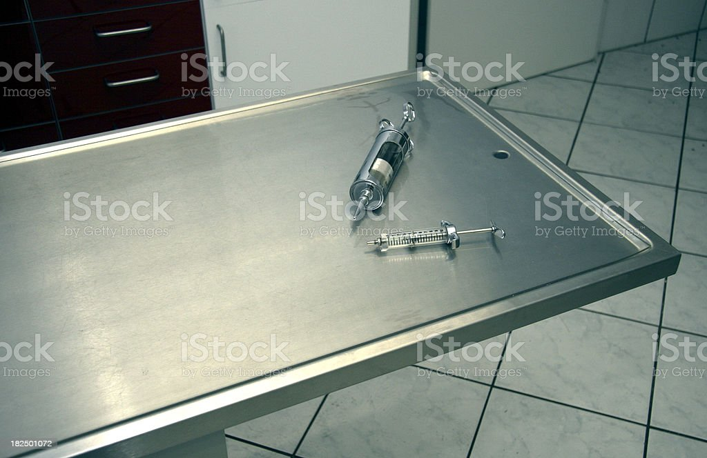 Surgery table with syringes stock photo