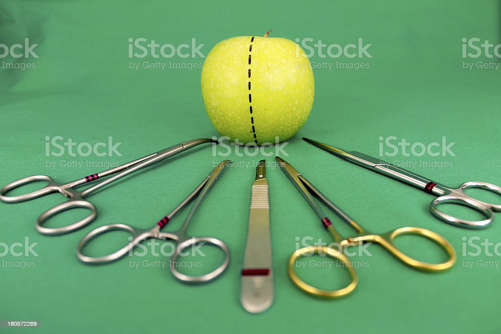 Surgical Equipments and Green Apple royalty-free stock photo