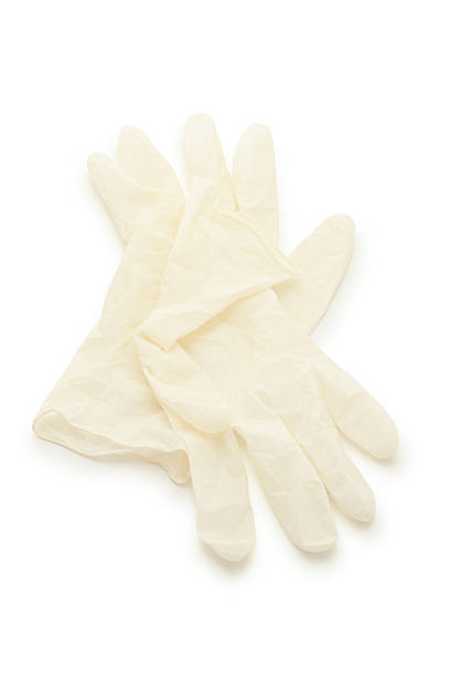 Surgical Gloves. Isolated on white with soft shadow. latex stock pictures, royalty-free photos & images