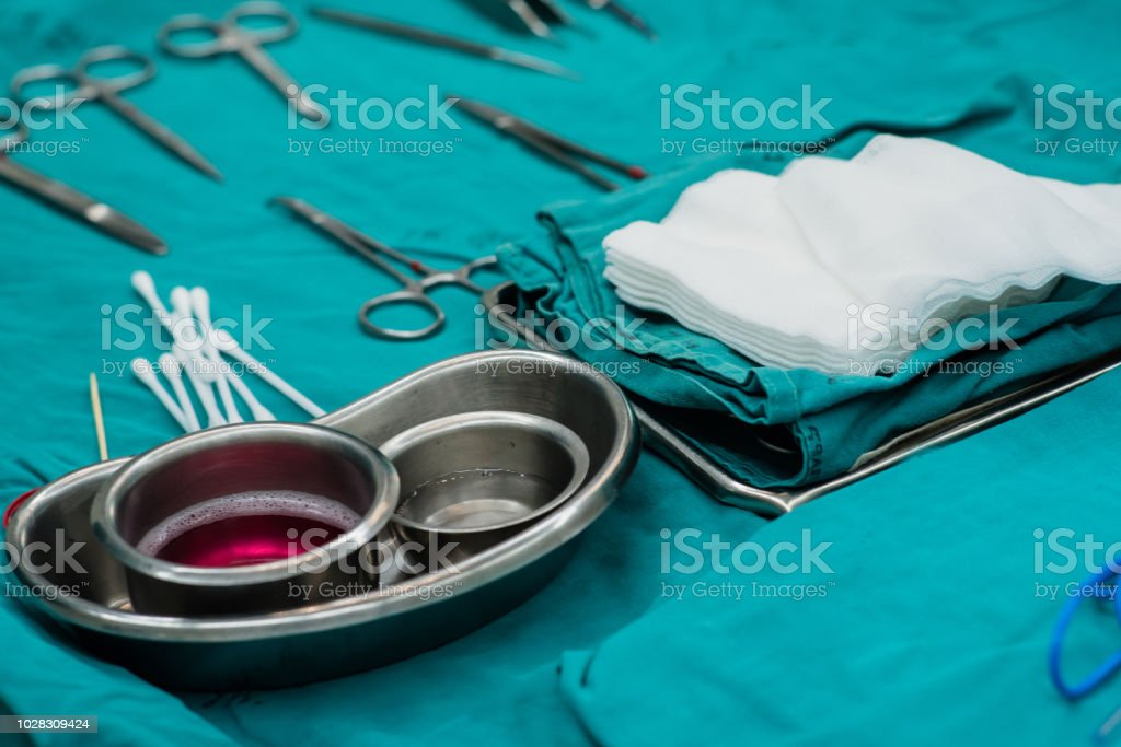 Surgical Instruments during surgery in operation room at the hospital. stock photo