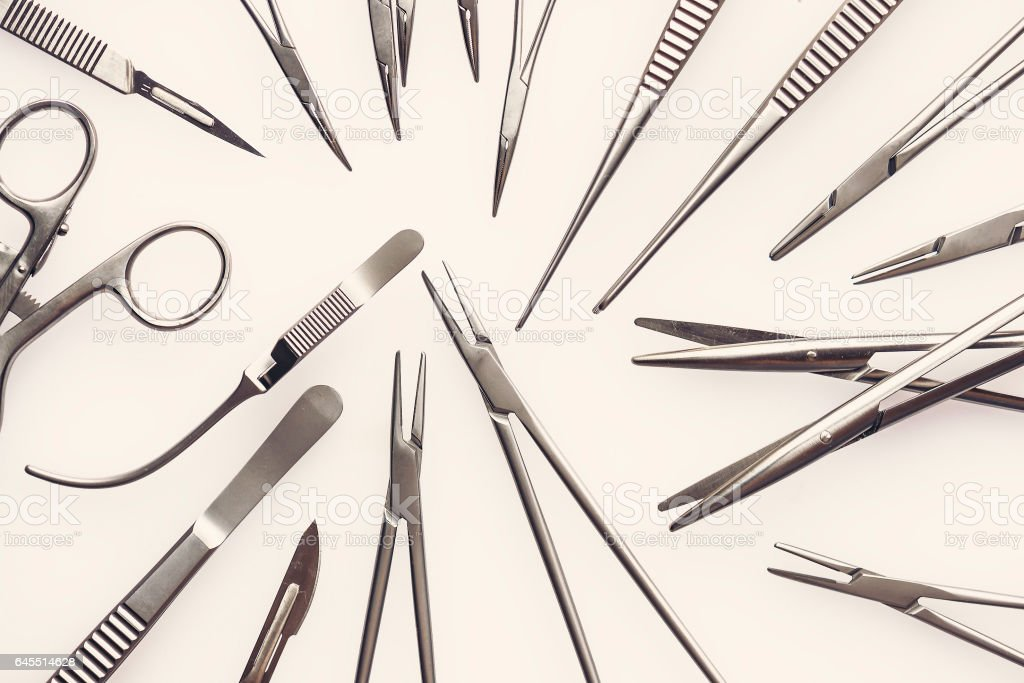 Surgical instruments on a white background stock photo