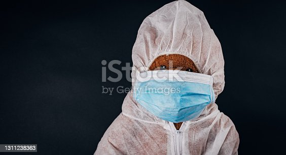 istock Surgical mask on teddy bear 1311238363