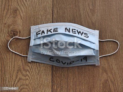 Coronavirus surgical mask with the words 'Fake News, Covid -19' inscribed on the mask.