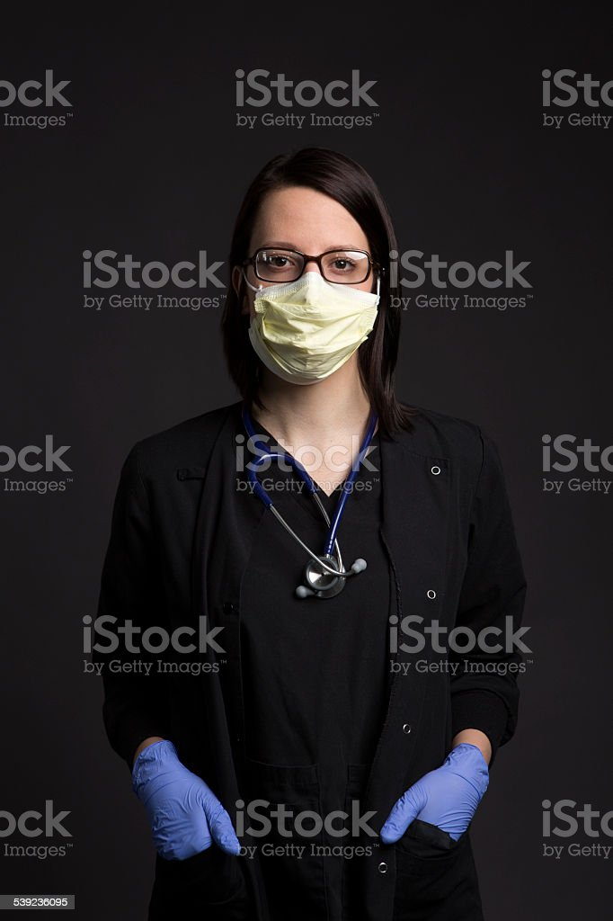 surgical mask wearing medical nurse with healthcare medicine vaccine syringe royalty-free stock photo