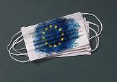 istock Surgical mask with European Union flag, Concept of global spread of Coronavirus Novel 2019-nCoV virus 1214461728