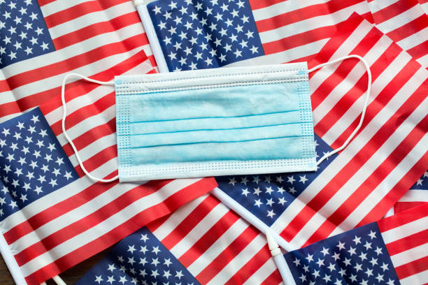 Surgical masks and American Flags stock photo