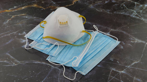 Surgical Masks and N95 respirator is a particulate-filtering respirator that meets the N95 standard of the U.S for coronavirus covid-19 stock photo