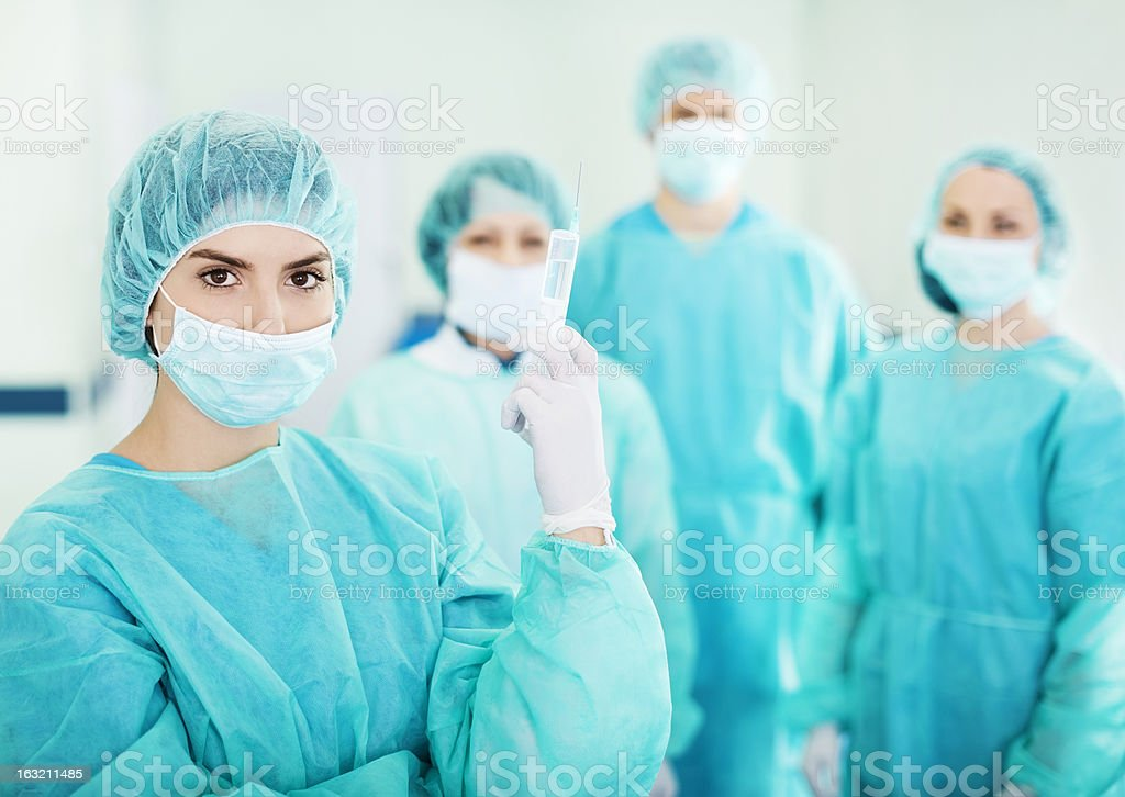 Surgical team in scrubs before starting surgery stock photo