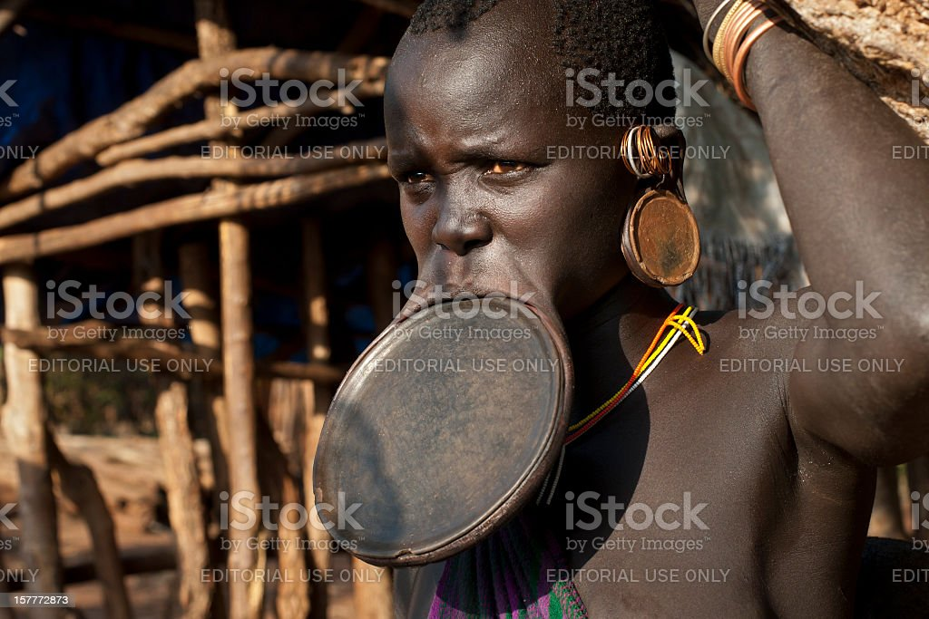 Surma woman with a huge lip plate, Southern Ethiopia stock photo
