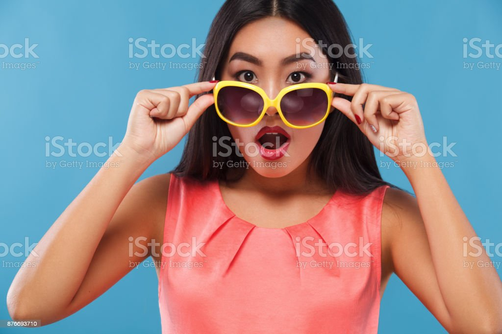 Surpised asian woman. Sale on Black Friday holiday. stock photo