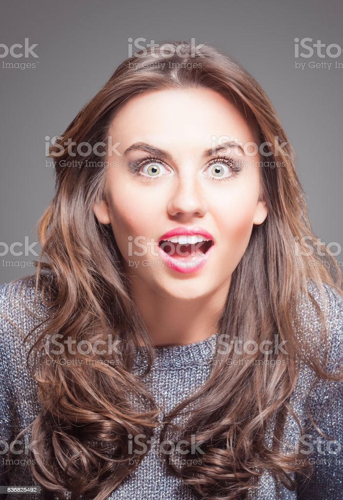 Surpised Beautiful Young Woman with Brown Long Hair and Contrasting Fashion Make up. stock photo