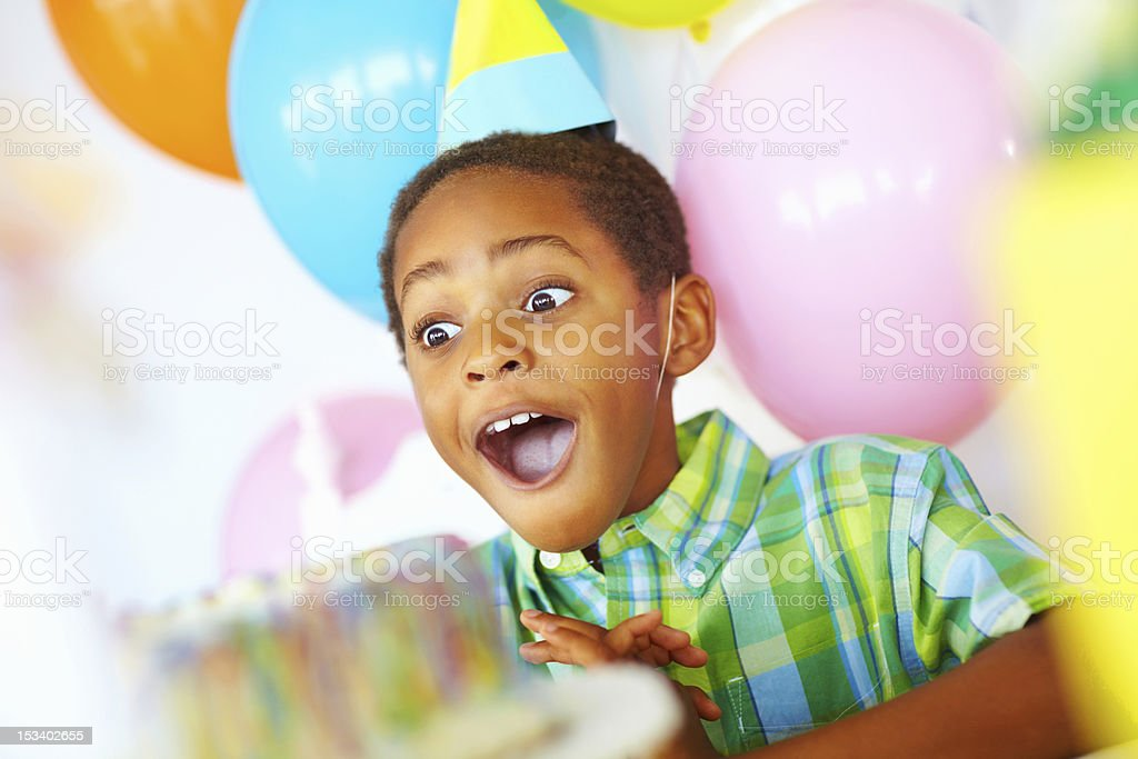 Surpised birthday boy stock photo